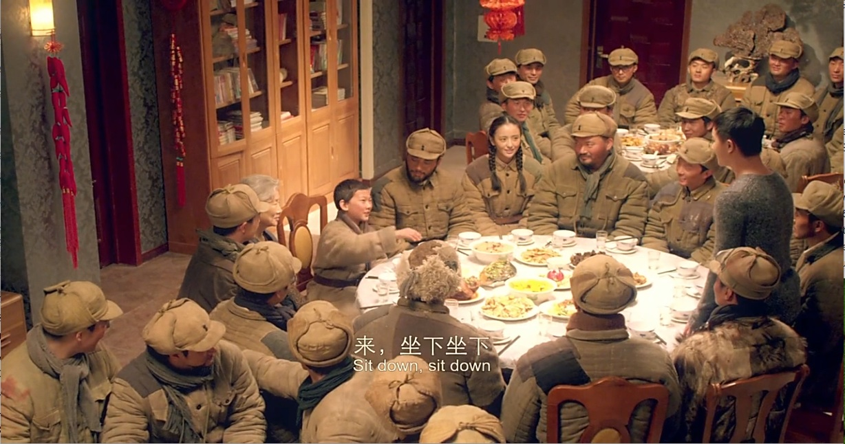 Figure 10. Chinese New Year's Eve family dinner with Jimmy, his grandfather Knotti, and the PLA squadron.