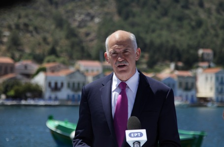 Former Greek Prime Minister Yorgos Papandreou announces the signing of the Memorandum